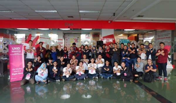 A group of indonesian people making hand gesture of the letter X