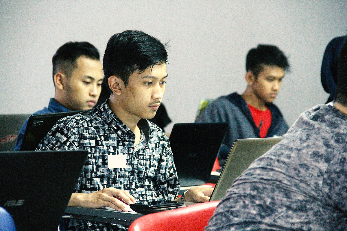 One of the participants working on his design