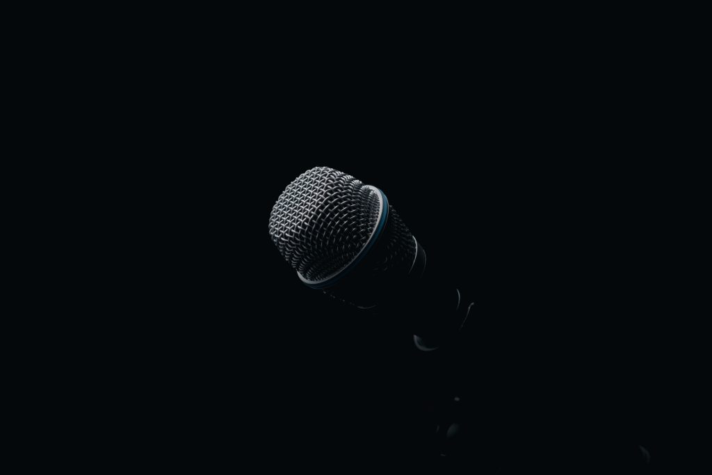 Black-microphone-faded-on-a-black-background
